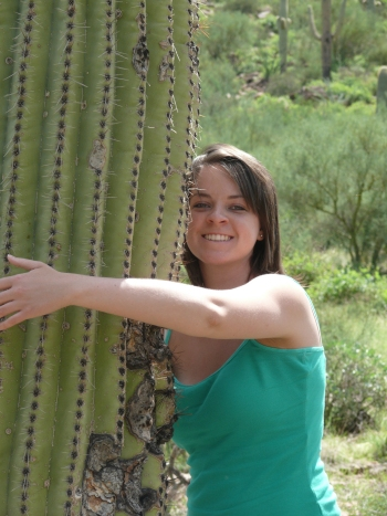 Katie hugging a Saguaro Cactus - very carefully